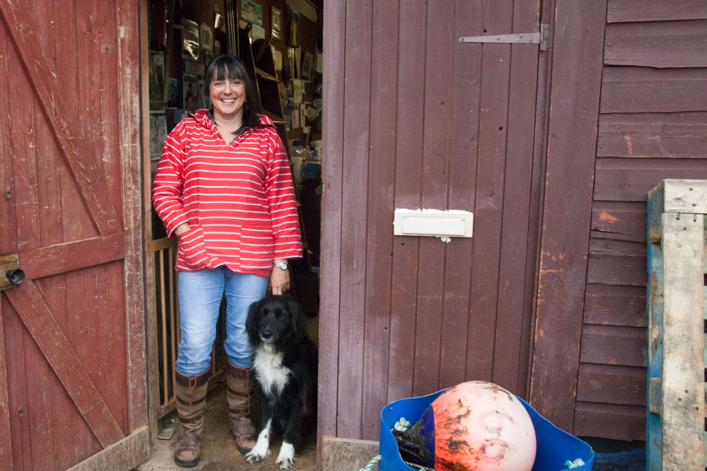 Sarah Cardew and her outside her store