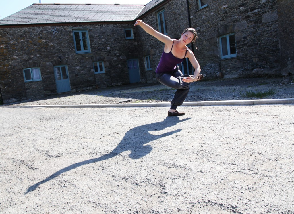 Gemma dancing in front of the barn